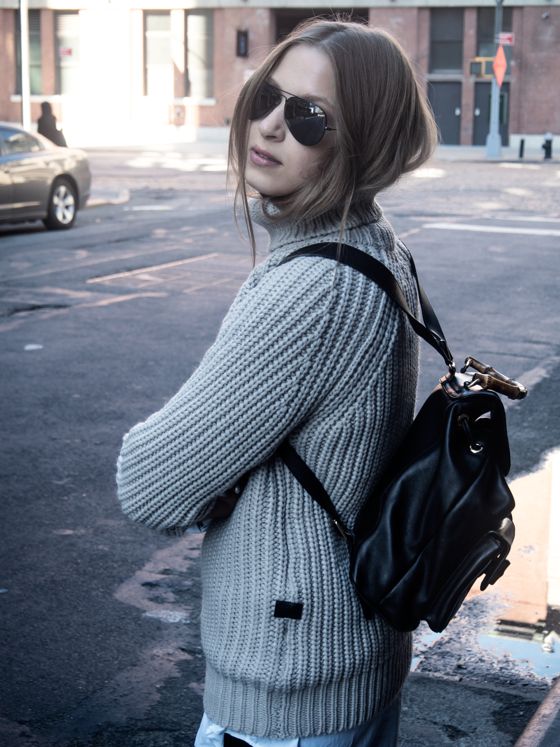 Meatpacking District – Catching last rays of sunshine wearing my cozy turtleneck